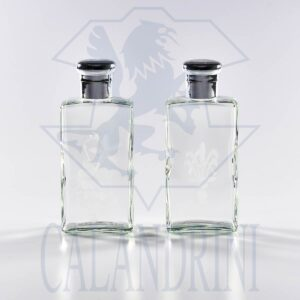 Pair of water and wine bottles in crystal with decorations
